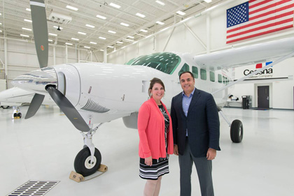 Jodi Noah, Cessna's senior vice president of single engine/propeller aircraft, and Emmanuel Anassis, Chairman, DAC with DAC's new Caravan EX